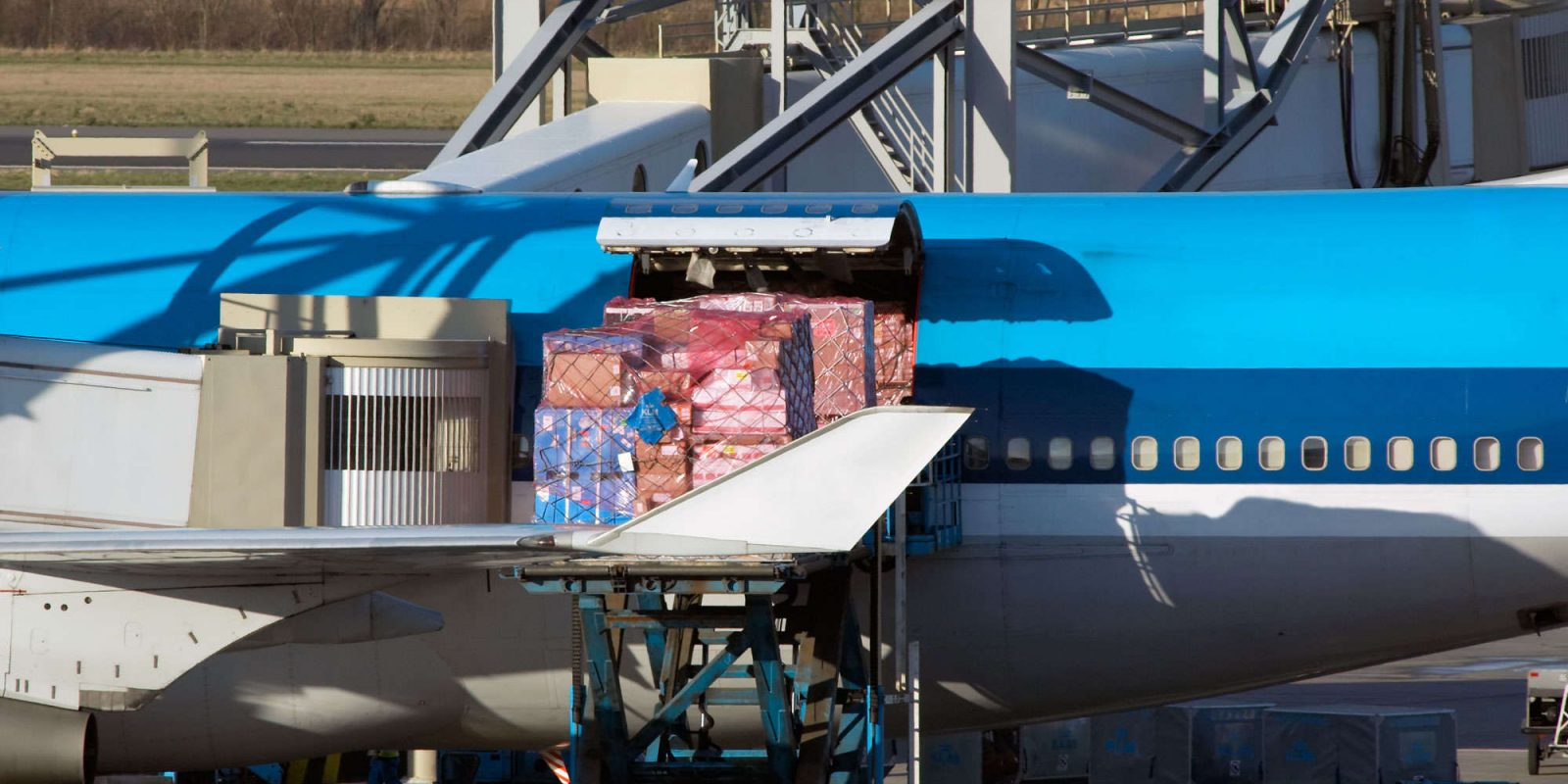 an aircraft unloading cargo at the airport